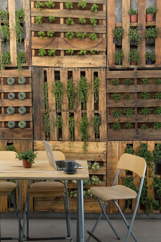 Flip your pallets in all different directions and use them as plant holders and growers. You're going to have a great looking fence and one with a fun pattern to it.