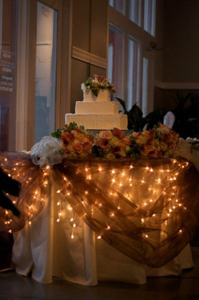Lights under cake table, bride and groom table and gift table