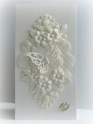 handmade wedding card from Paper Fever ,,, white on white ... layers of die cut flowers, flourishes and lacy frame ... gorgeous card!: