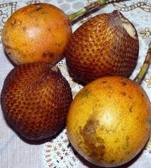 This fruit is called Salak, and you can eat it in Bali.  We called them 'snake balls' due to the scaly looking skin