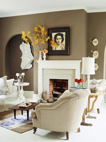Fall Mantel Decor  Spice up your living room with a spot of fall color. Arrange tall branches with bright leaves inside a vase and place on your mantel or shelf.
