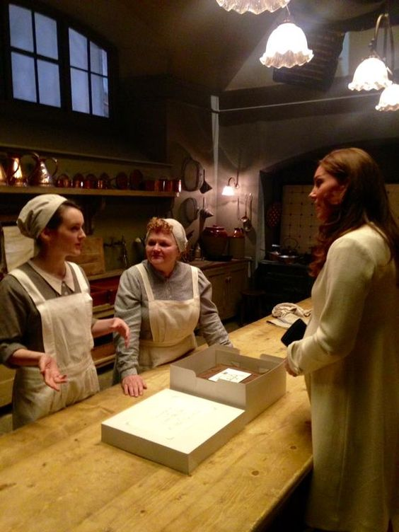 "The Duchess receives a cake from ""Daisy"" and ""Mrs. Patmore"" on the set of Downton Abbey 3/12/15. #Kate #Middleton:"