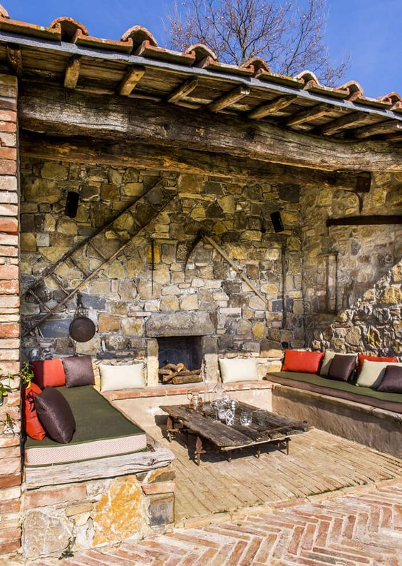 Rustic stone loggia with fireplace in a farmhouse in Tuscany, Italy designed by D.Mesure - Elodie Sire