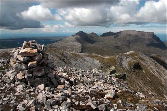 """Scotland's Top walks: Quinag, Sutherland   This remote, ice-scoured peak overlooks Diarmid's home in Assynt. For walkers, the steep cliffs and spineback ridge prove spectacular (if relatively easy) sport. The fact that the car park is already at 250m helps with the romp up the grassy lower slopes to the 808m summit. """"From the top, you look across a very ancient landscape,"""" says Diarmid. """"It's 3.5 billion years old and fascinating geologically."""" The name of the mountain means """"milking stool"""""""