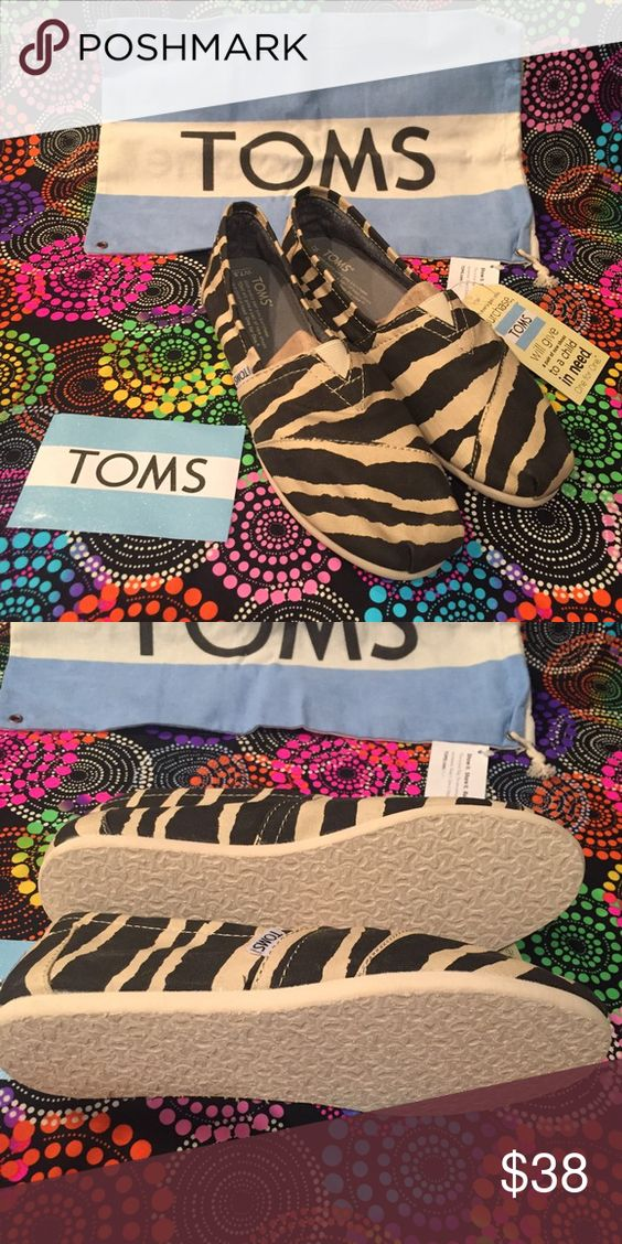 Brand New Pair Women's Zebra Print Toms These have never been worn! Still have the tag!  I have plenty of items listed and offer discounts on bundles!  I am trying to downsize my closet so I DO NOT TRADE!!! TOMS Shoes Flats & Loafers
