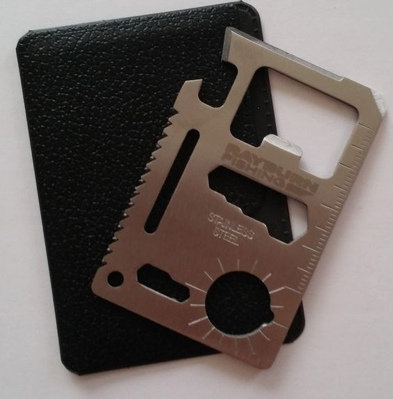 11 in 1 Credit Card Wallet Knife. Stainless Steel Survival Multitool Utility. Perfect Tool for Bug Out Bag, Camping or Fishing. Tools Include Knife, Saw, Bottle Opener, Can Opener, Slot Head Screwdriver, Ruler, 4 Position Wrench and More!