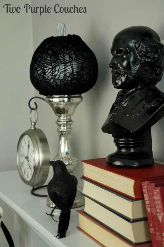 Complete your spooky literary-inspired Halloween mantel decor with a bust of a dead author. via www.twopurplecouches.com