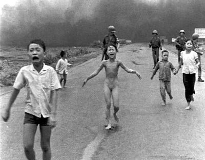 The girl in the centre of this photograph is 9 year olf Kim Phúc. She is running from a napalm attack which caused serious burns on her back. The boy is her older brother. Both survived. This photo (by Huynh Cong Ut) became one of the most published of the Vietnam war.