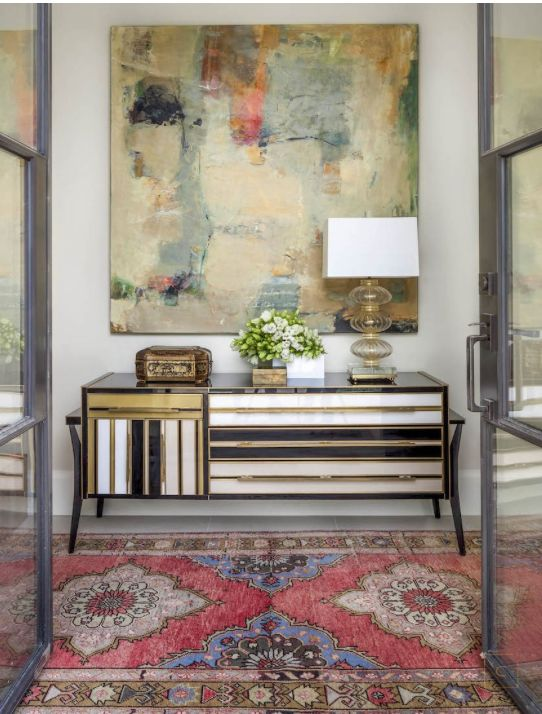 Entry with chic cabinet eye catching rug entry foyers for Foyer ideas pinterest