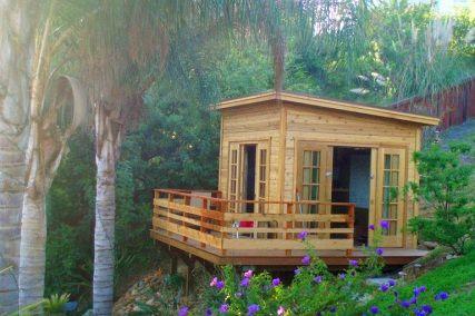 Tiny backyard she caves backyard garden studio kits for Shed guest house kit