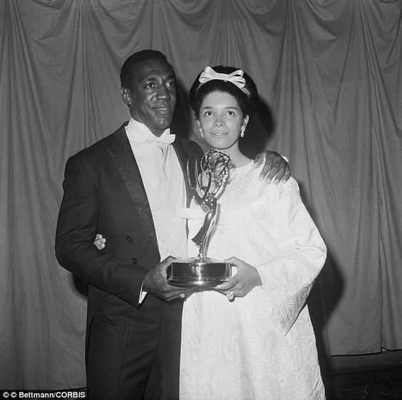 Cosby is congratulated by his pregnant wife, Camille, after receiving the Emmy award for b...