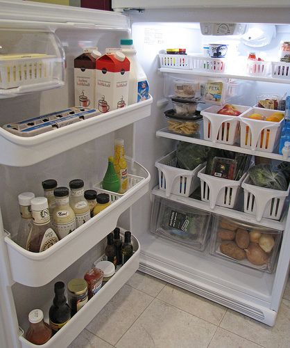 Use baskets INSIDE the refrigerator to group like items. They keep those science experiments out of the rear of the fridge, make the good foods easier to grab, and shelves stay cleaner longer.