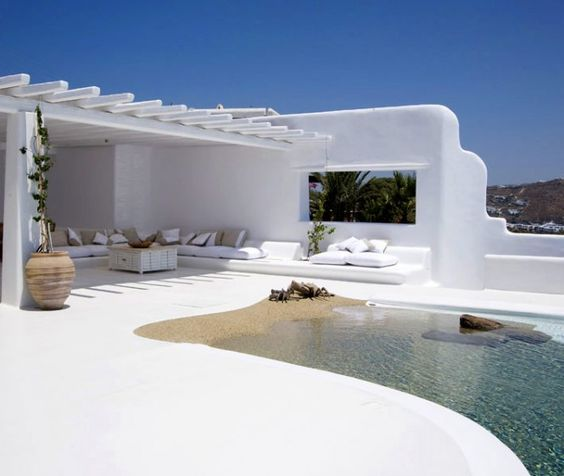 ... to blue skies and crisp white houses with a pool that looks like a beach right at your doorstep!