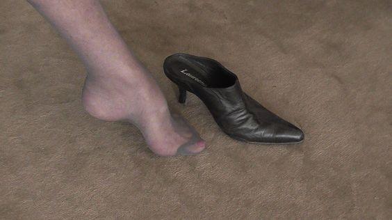 black pointy clogs