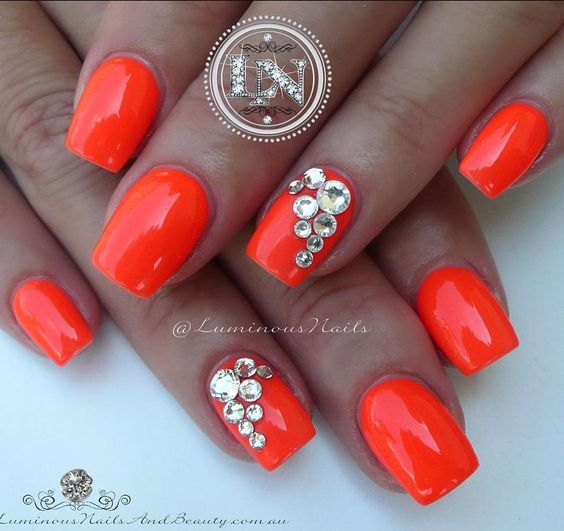 Bright Orange Nails with Swarovski Bling!  Acrylic Overlay with @gellyfitaustralia Candy Collection CA919 & Swarovski Crystals. #gellyfitaustralia #swarovskicrystals #bling #sparkle #neon #bright #orange #luminousnails #luminous #acrylicnails #gelnails #nailartist #nailartebook #luminousnailsandbeauty #byteena #goldcoast #queensland #australia #icing #frosting