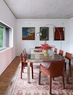 Dining room decor ideas |  Artworks by, from left, Y. Mahalyi, Arcangelo Ianelli, and Tomie Ohtake survey the dining room's Estudio Campana table |www.bocadolobo.com #diningroomdecorideas #moderndiningrooms