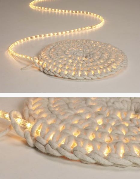 What a cool idea. Crochet around a rope light to create a light-up rug. Great for a covered patio outside at night.: