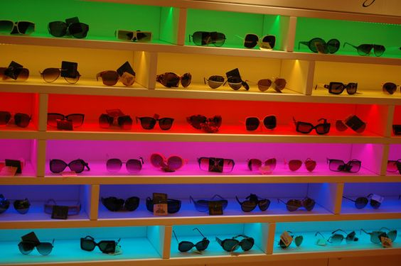 A Cool And Colorful Display Of Sunglasses At An Eyeglass