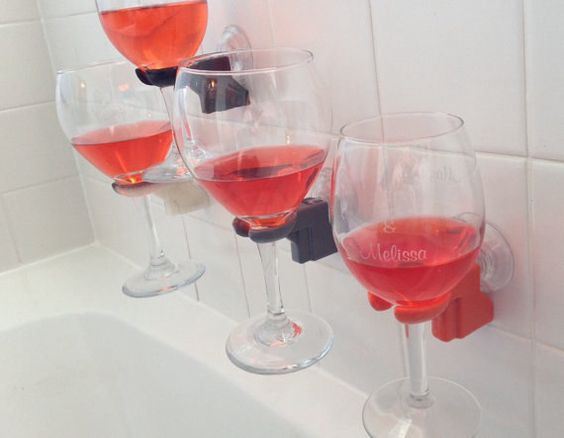 A bathtub wine glass holder.