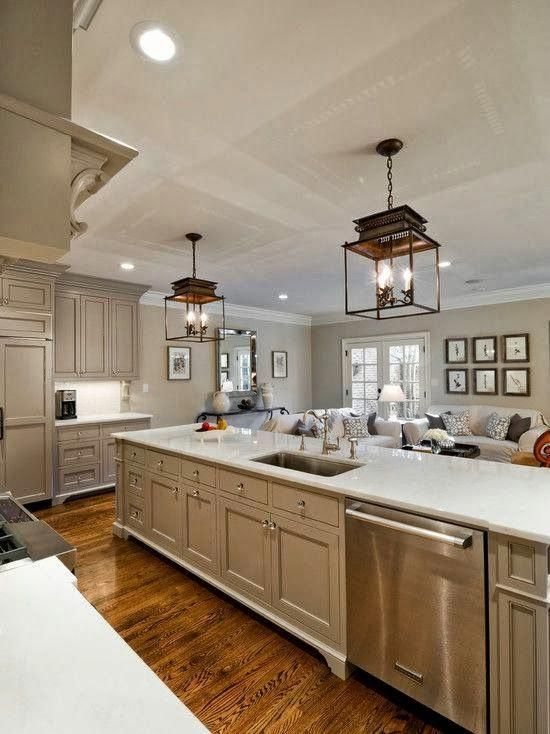 Huge Open Galley Kitchen With Lots Of Workspaces And Sink On The