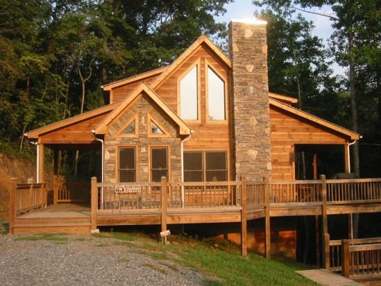 Pictures of log cabins with wrap around porch for Small log cabins with wrap around porch