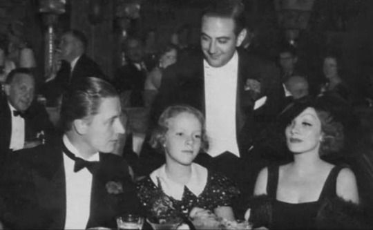 Marlene Dietriech with her husband and daughter in a restaurant, 1935: