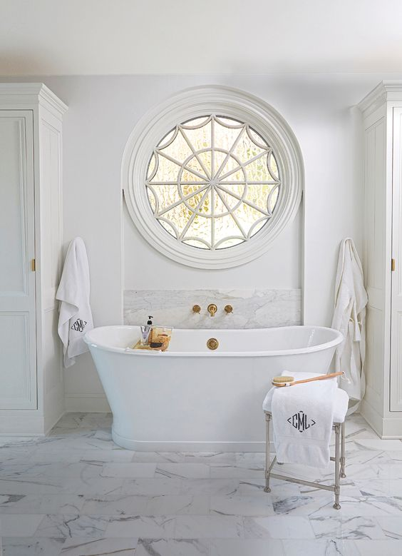 Beautiful White Marble bathroom interiors with brass fixtures. Similar Marble tiles can be sourced from Mandarin Stone. www.mandarinstone.com