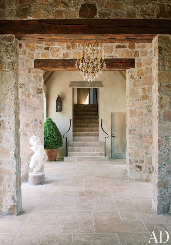 French country interior and French farmhouse decor inspiration: the stone entry to a Napa Valley home. #frenchfarmhouse #frenchcountry #limestone #interior
