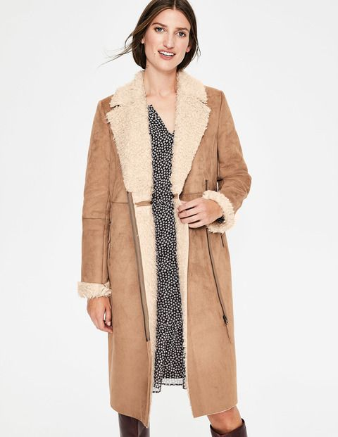 this coat is the sartorial equivalent of a hot chocolate with extra marshmallows warm and oh so desirable when the te faux shearling coat shearling coat coat pinterest