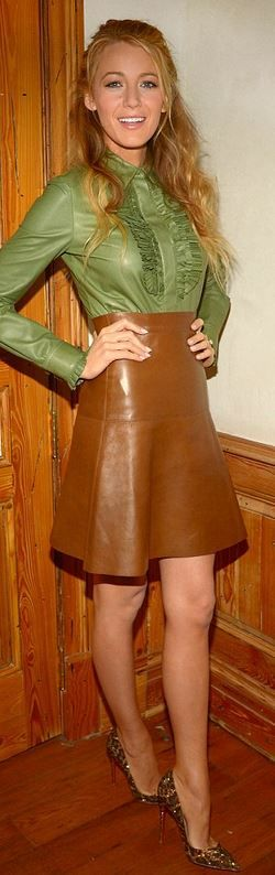 Brown leather skirt, tucked in vintage shirt.: