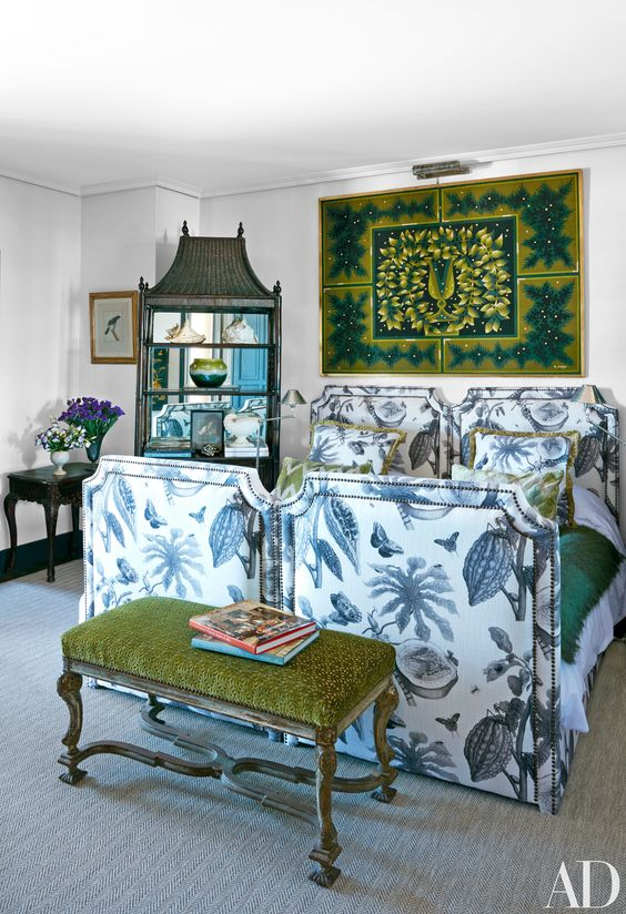 Need decorating inspiration for your summer house? In a guest room at decorator Lorenzo Castillo's oceanside escape in Spain, a tropical-inspired fabric covers a pair of twin beds. | archdigest.com: