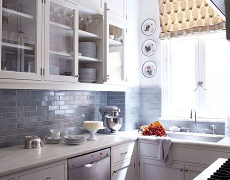 Cool Blue-Gray Kitchen                                                          A backsplash of blue-gray Metro subway tile is paired with white cabinets in this small but distinctive Park Avenue kitchen designed by Daniel Sachs.