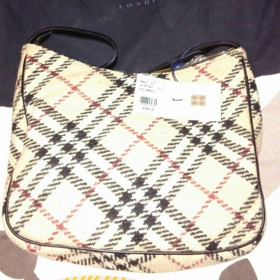 Authentic Burberry Winter wool handbag never worn with tags and garment bag. Burberry Bags