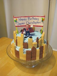 Superhero Birthday Cake Idea. 2 layer cake with sugar wafers cut in to building shapes