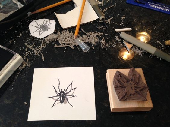 Spider stamp carved by Dennis Rush