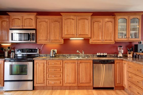 Red kitchen walls kitchen walls and red kitchen on pinterest for Dark red kitchen cabinets