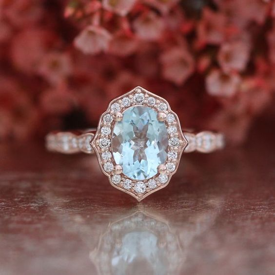 Vintage aquamarine engagement ring with scalloped rose gold band.