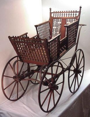 This Oak Victorian Carriage was made by J. B. Sweet & Son Mfg. Co. Buffalo, N. Y. maker of Children's Carriages. It probably dates around the 1850's.    The Carriage appears to have its   original finish, and is built with   suspension springs to provide a smooth ride.