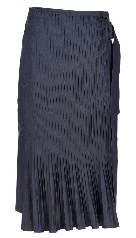 A runway favorite, this lightweight denim skirt combines a sense ...