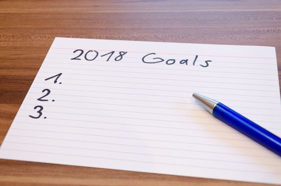 Writing on paper about goals-boomer