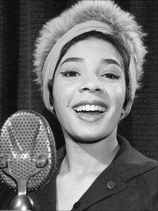 """Nyy'xai Shirley Bassey, Music Artist (""""Goldfinger"""")."""