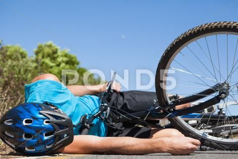 Cyclist Lying On The Road After An Accident Stock Photos Ad