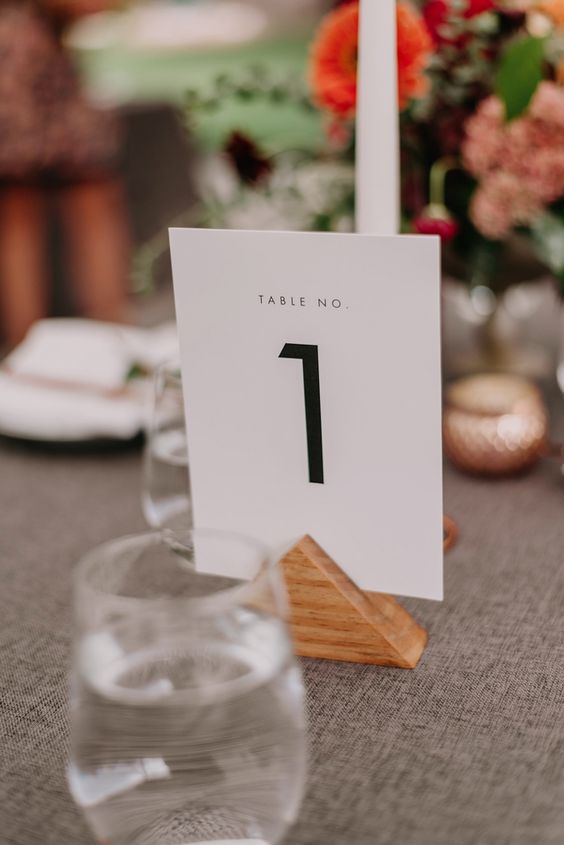 Simple + modern black and white table number signage at this summer wedding | Image by June Cochran Photography