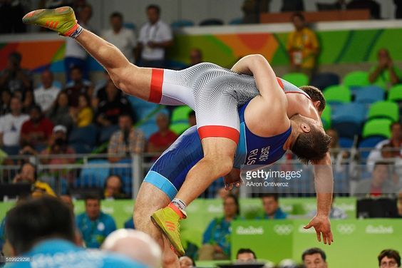 Sergey Semenov of Russia lifts Heiki Nabi of Estonia for points en route to winning bronze during 130kg Greco Roman wrestling action on Monday, August 15, 2016