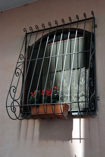 Window With Grille Flowers And Curtain Procida Na