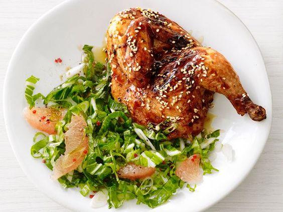 ... game hens alongside leafy bok choy and plump grapefruit slices