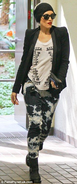 Gwen Stefani manages to pull off sexy in bleached jeans, clumpy boots and beanie hat | Mail Online