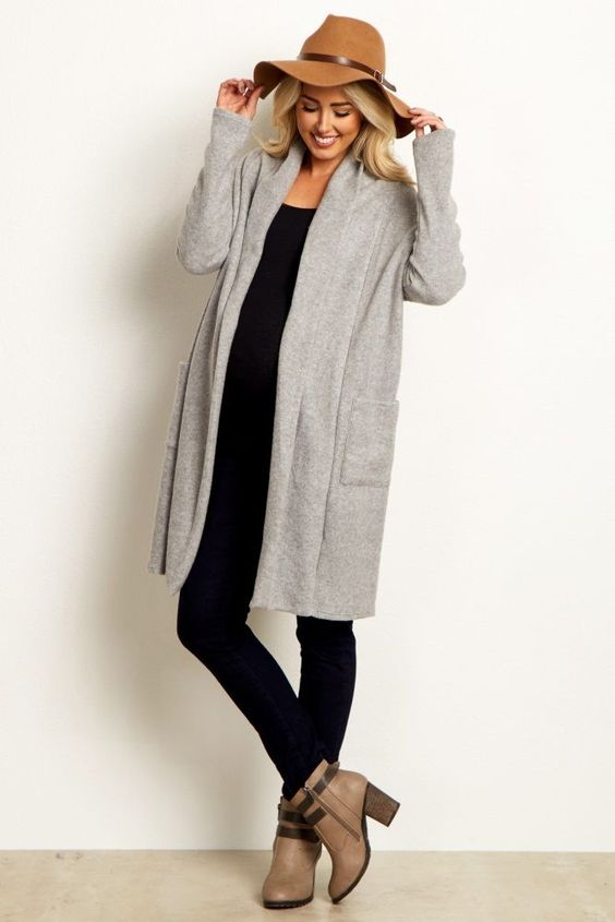 When we say soft, we're talking about this super soft long sleeve maternity cardigan. Long sleeves and front pockets make this the ultimate essential when the cold weather rolls in. An open front makes this maternity cardigan an easy piece to layer over any basic maternity top. Pair with maternity leggings and boots for a complete ensemble.  Perfect for women's and maternity.