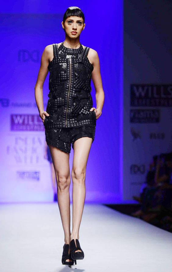 Model walks the ramp for designer Anand Bhushan on day four of Wills Lifestyle India Fashion Week 2013. #Fashion #Style #Beauty #WIFW