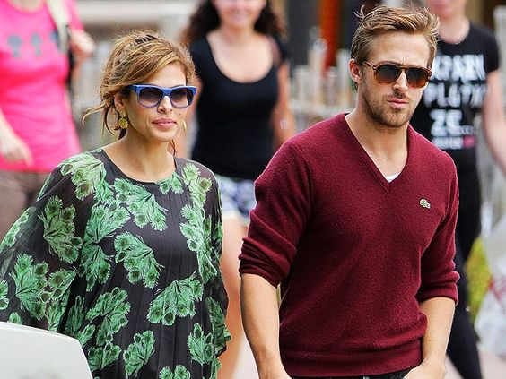 Cute couple Eva Mendes and Ryan Gosling head off for a lovers getaway in their shady best - blue for her & tort for him
